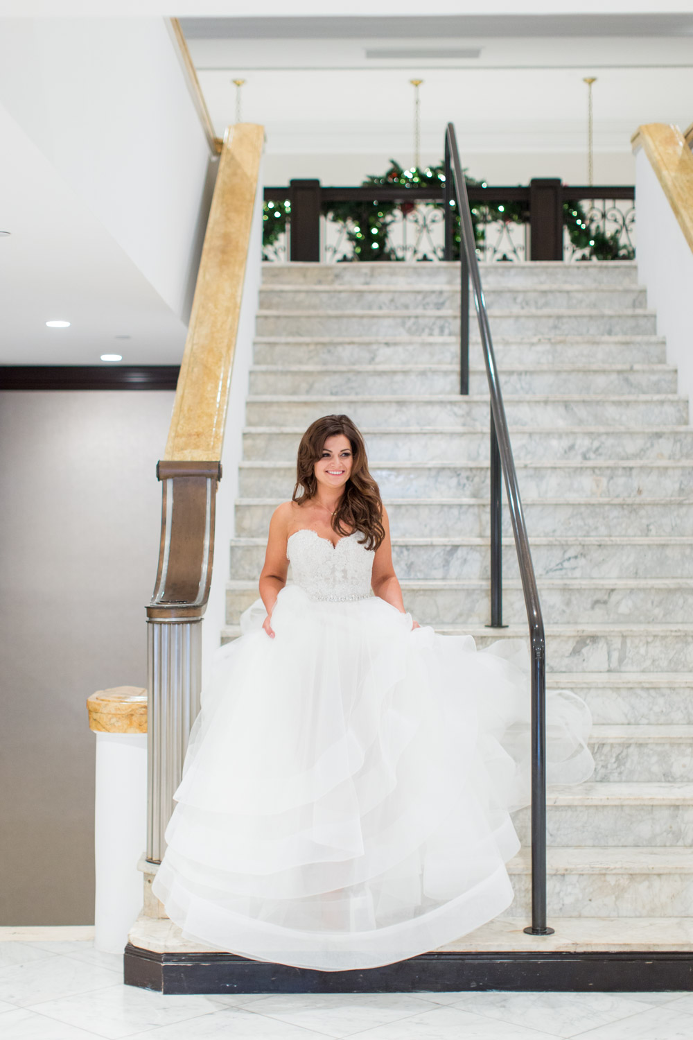 Bride walking down the stairs at her US Grant wedding, Cavin Elizabeth Photography