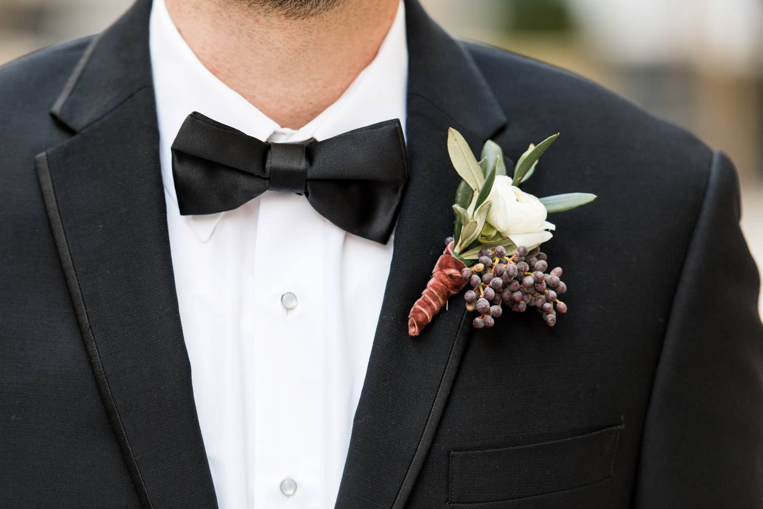 Groom's boutonniere with white green and red, Cavin Elizabeth Photography