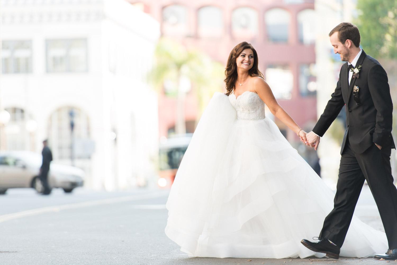 Bride and groom crossing the street downtown San Diego, modern urban chic luxury wedding photography, Cavin Elizabeth Photography