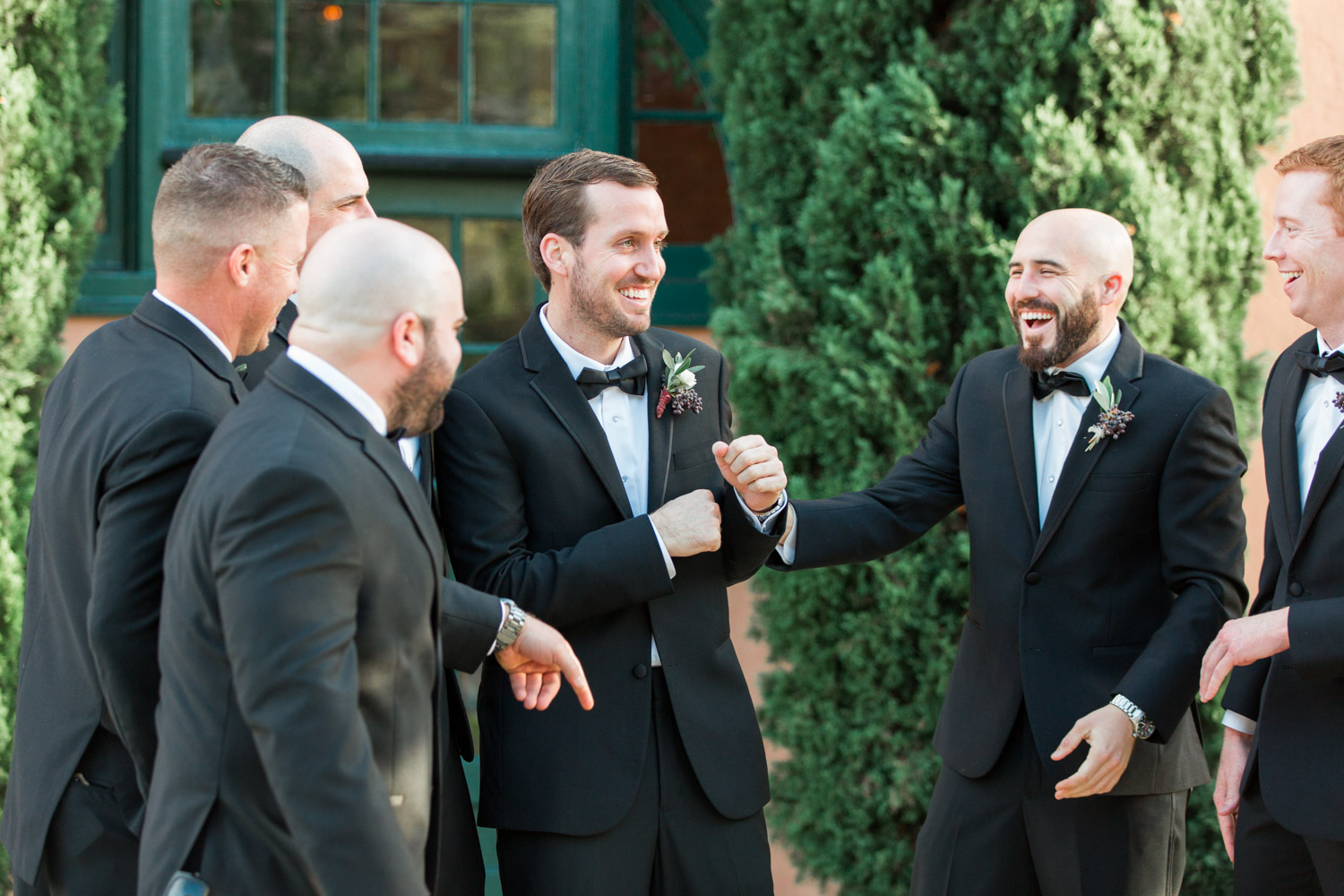 Candid groom and groomsmen hanging out at BRICK in Liberty Station, Cavin Elizabeth Photography