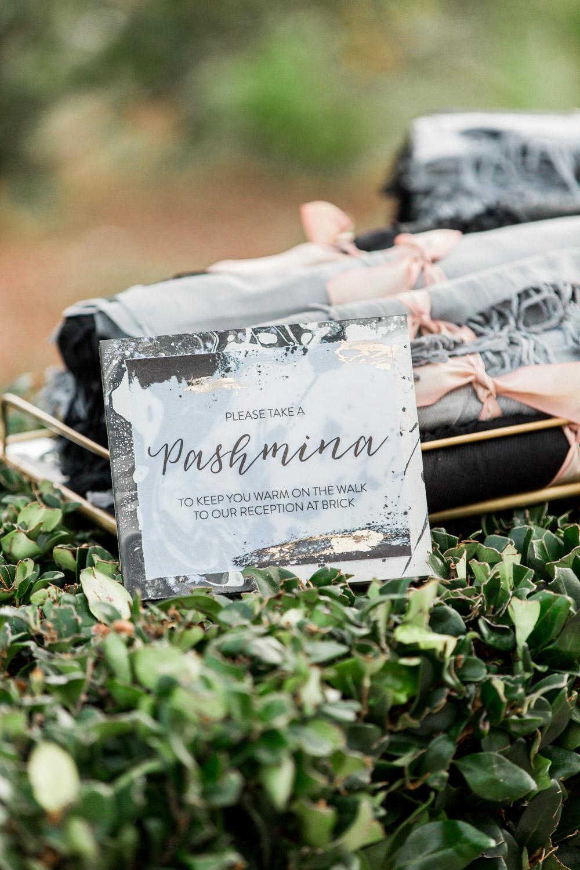 Pashminas for winter weddings with stylish sign by Peanut PressBride and groom luxury wedding portrait in San Diego at a BRICK wedding, Cavin Elizabeth Photography