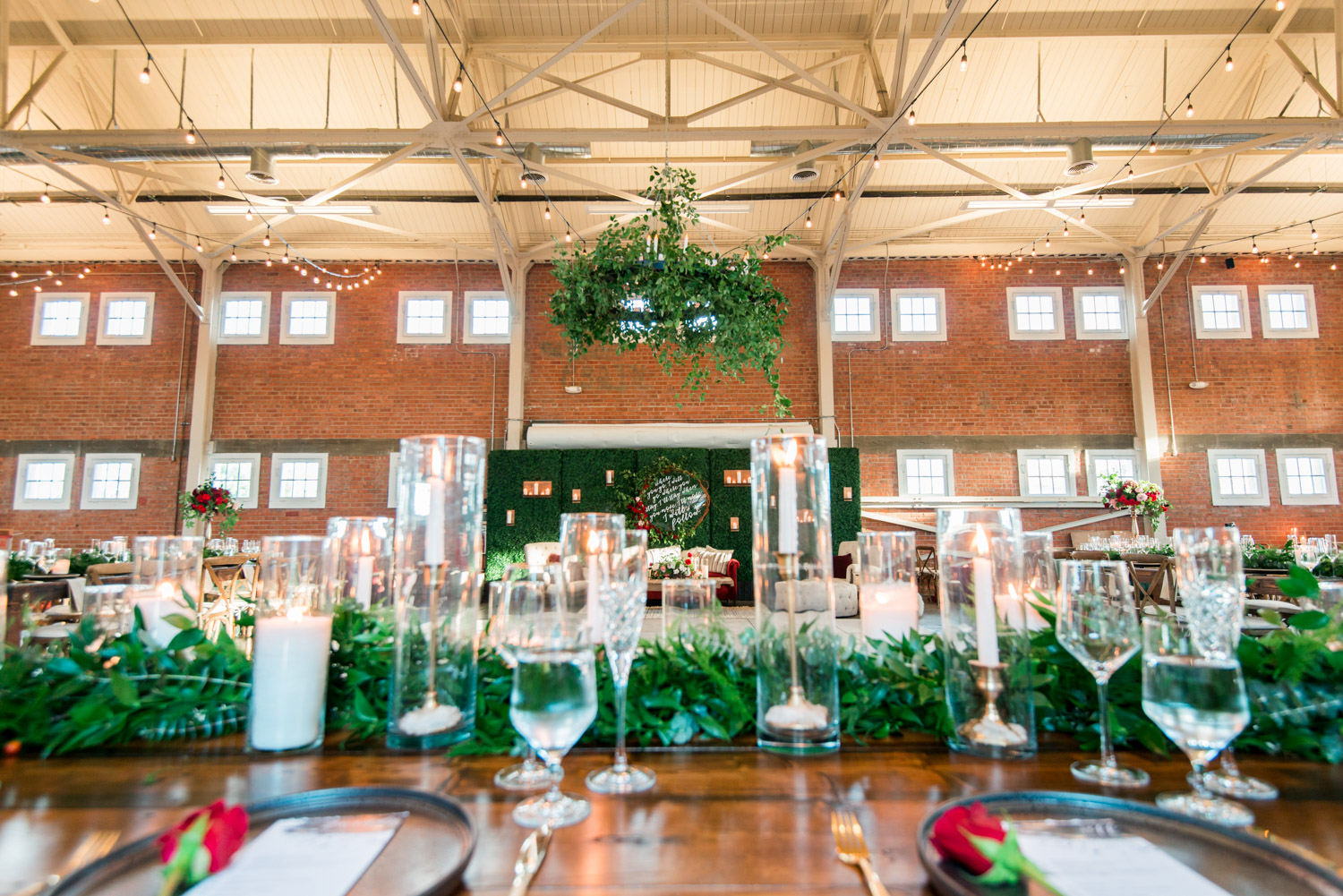 BRICK wedding reception with winter green blue and red flowers by Bloom BabesThe North Chapel wedding ceremony in San DiegoBride and groom luxury wedding portrait in San Diego at a BRICK wedding, Cavin Elizabeth Photography