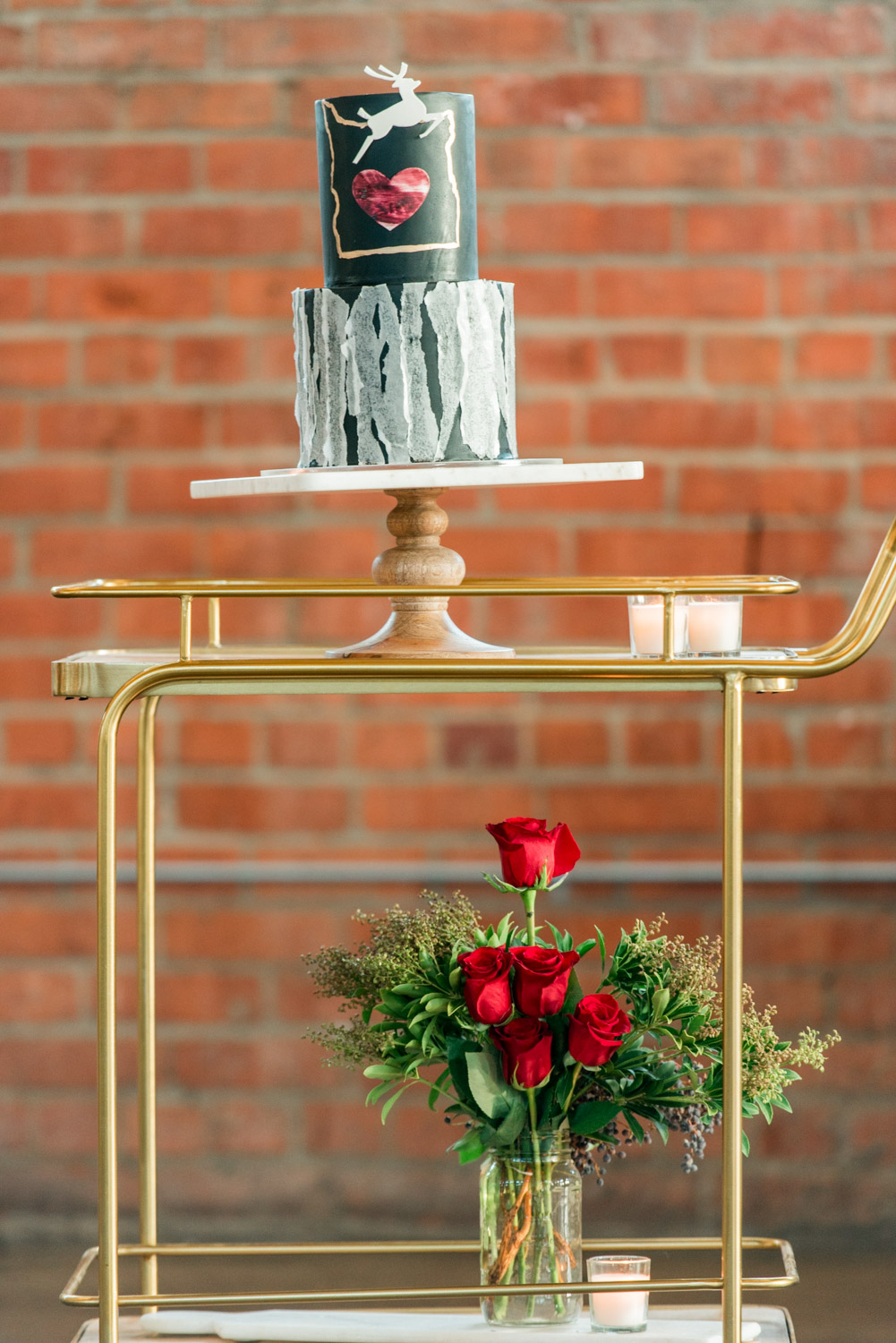 Hey There Cupcake groom's black wedding cake with deer and heart on a bar cart, Cavin ELizabeth Photography