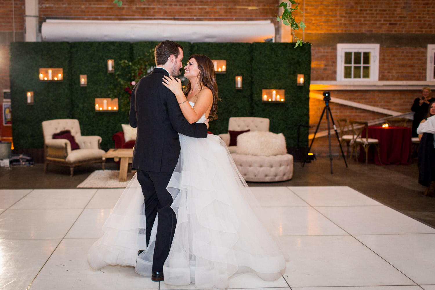 Bride and groom first dance at BRICK in Liberty StationHey There Cupcake groom's black wedding cake with deer and heart on a bar cart, Cavin ELizabeth Photography