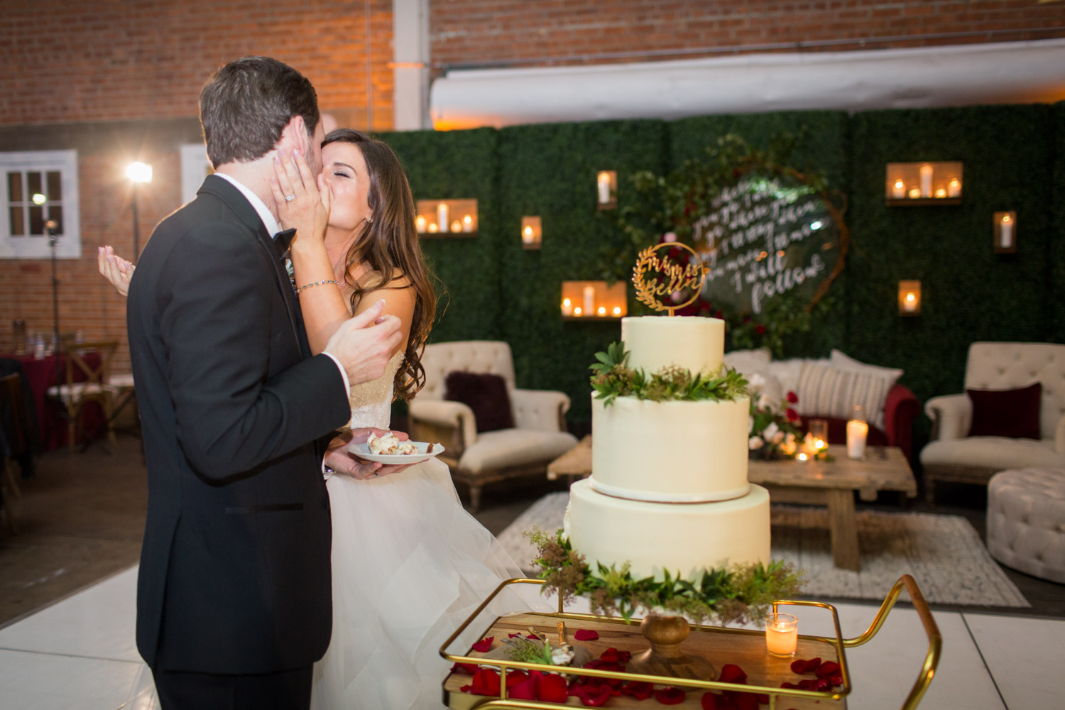 Bride and groom cake cutting of a three tier white wedding cake with gold acrylic cake topper at a luxury high end wedding in San Diego, Cavin ELizabeth Photography