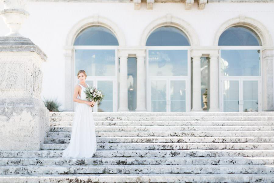 Bride posing on steps