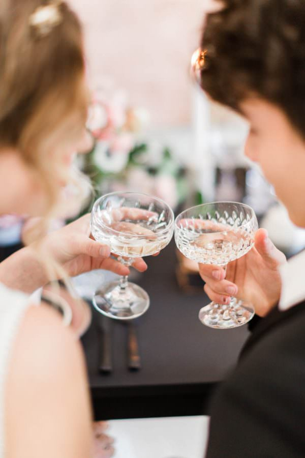 Bride and groom champagne cheers toast at their gorgeous rehearsal dinner, Cavin Elizabeth Photography