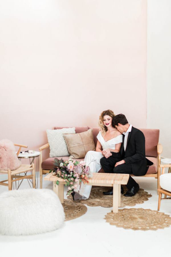 Pink lounge for wedding or cocktail hour, Bride and groom at after party for wedding, bridal white jumpsuit with hair down and curled paired with a bold deep red lipstick, Cavin Elizabeth Photography