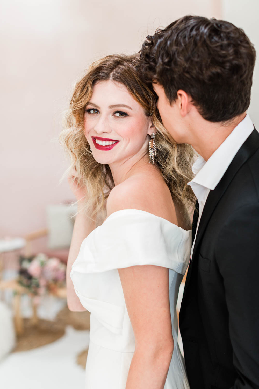 Bride and groom at after party for wedding, bridal white jumpsuit with hair down and curled paired with a bold deep red lipstick, Cavin Elizabeth Photography