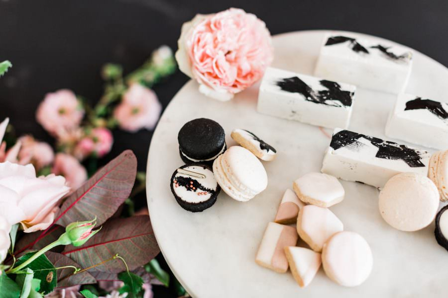 Black and white macarons, pink blush and white cookies, white desserts with black brush strokes, San Diego wedding film photographer, Hey There Cupcake small wedding desserts on gold and white marble platters, Cavin Elizabeth Photography