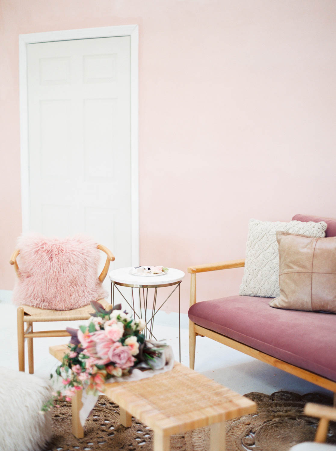 San Diego film wedding photo of a Pink and white wedding lounge for an after party or cocktail hour, Cavin Elizabeth Photography and Amorology