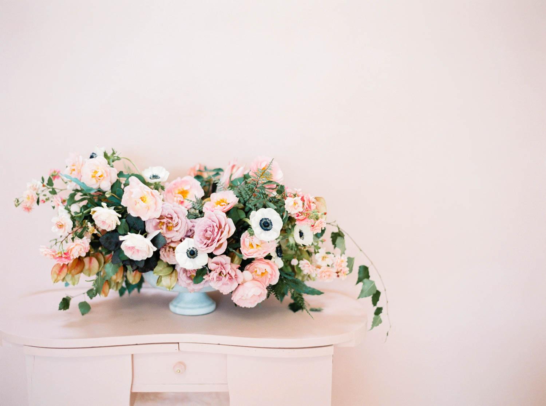 San Diego film wedding photo, Black pink and gold wedding inspiration, large pink white green centerpiece on blush background, Cavin Elizabeth and Amorology