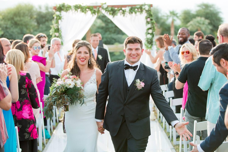 Bride and groom walking down aisle just married, Wedding ceremony at Desert Ridge Estate, Cavin Elizabeth Photography