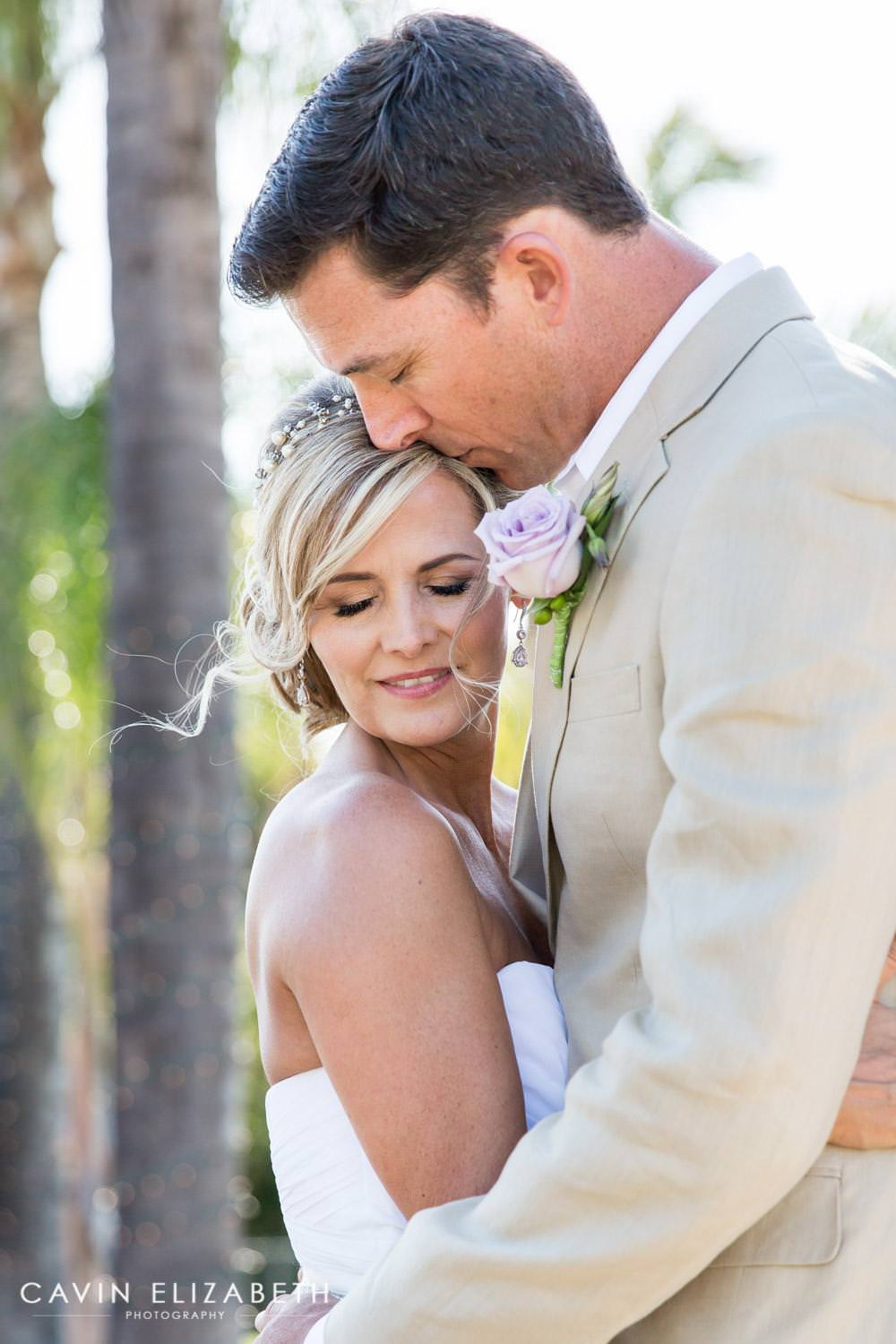 adorable bride and groom photo idea, groom kisses his bride on her head while holding her close, cavin elizabeth photography