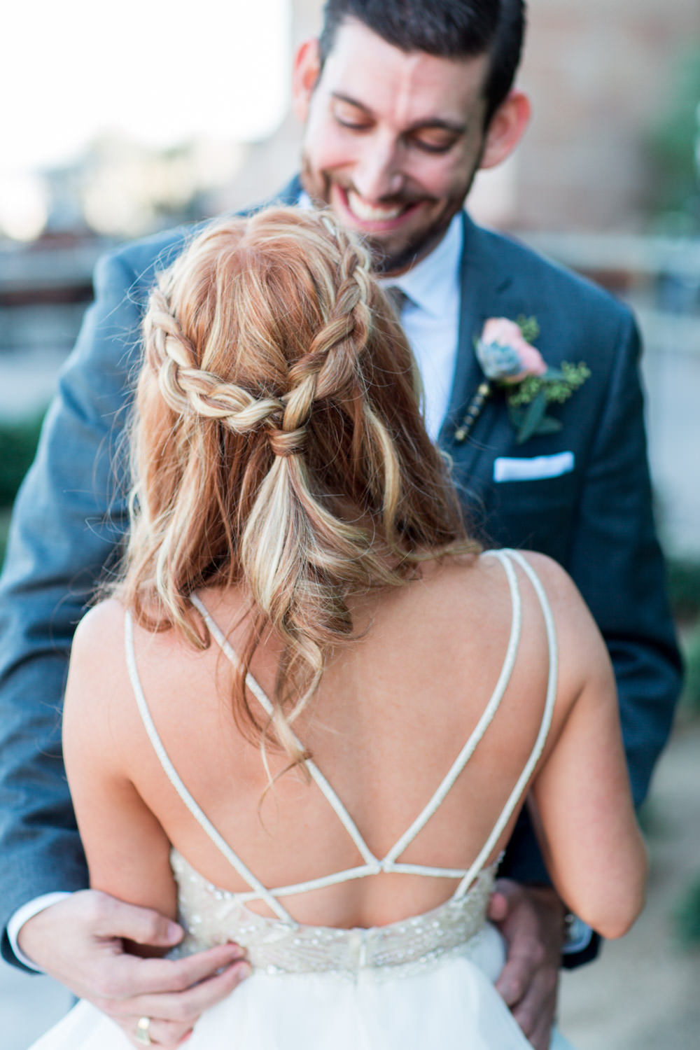 Bridal half up braid hairstyle, Indian Wells wedding first look in front of a greenery wall and bride and groom portraits, Cavin Elizabeth Photography