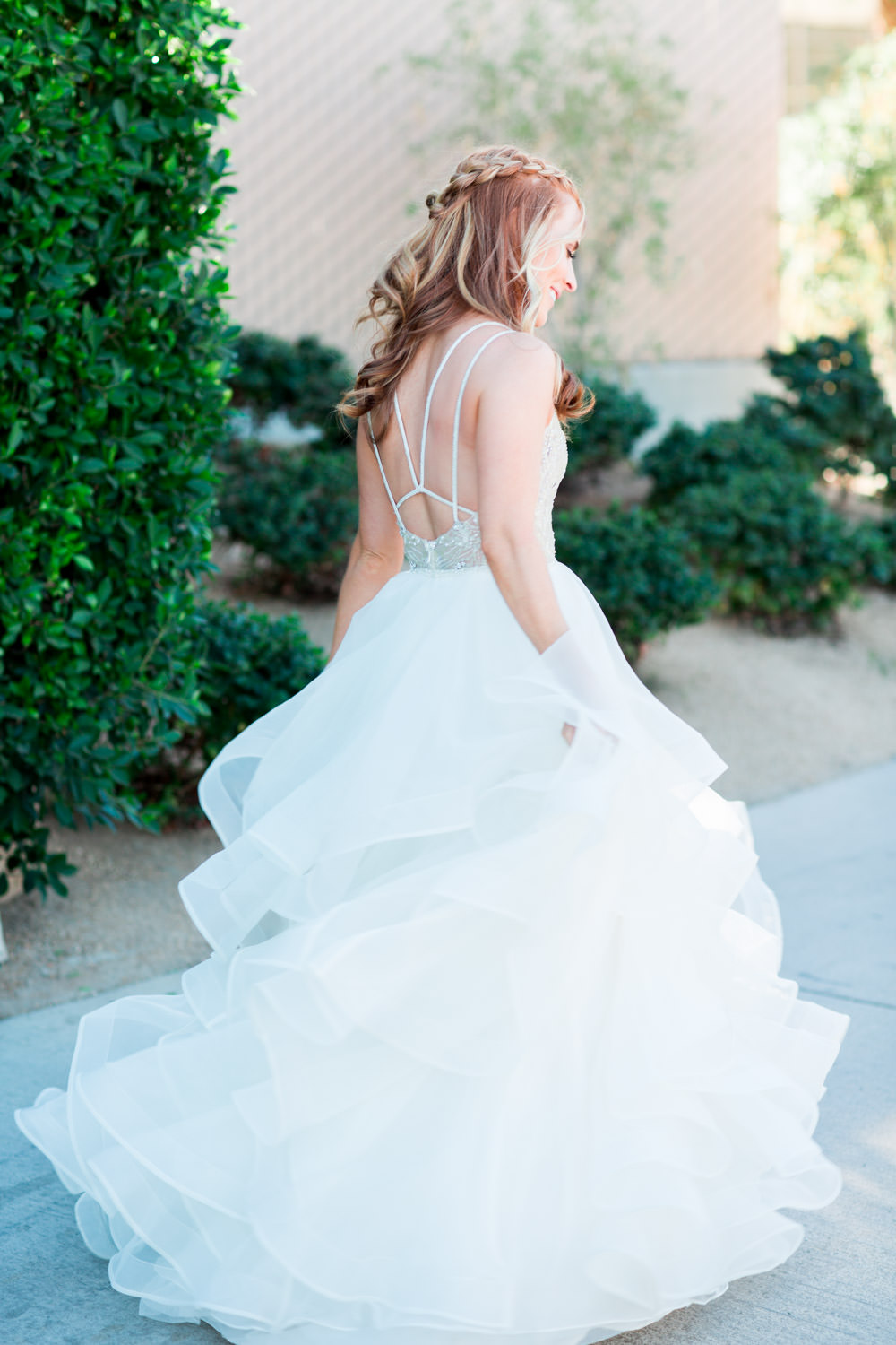 Indian Wells wedding first look in front of a greenery wall and bride and groom portraits, Cavin Elizabeth Photography