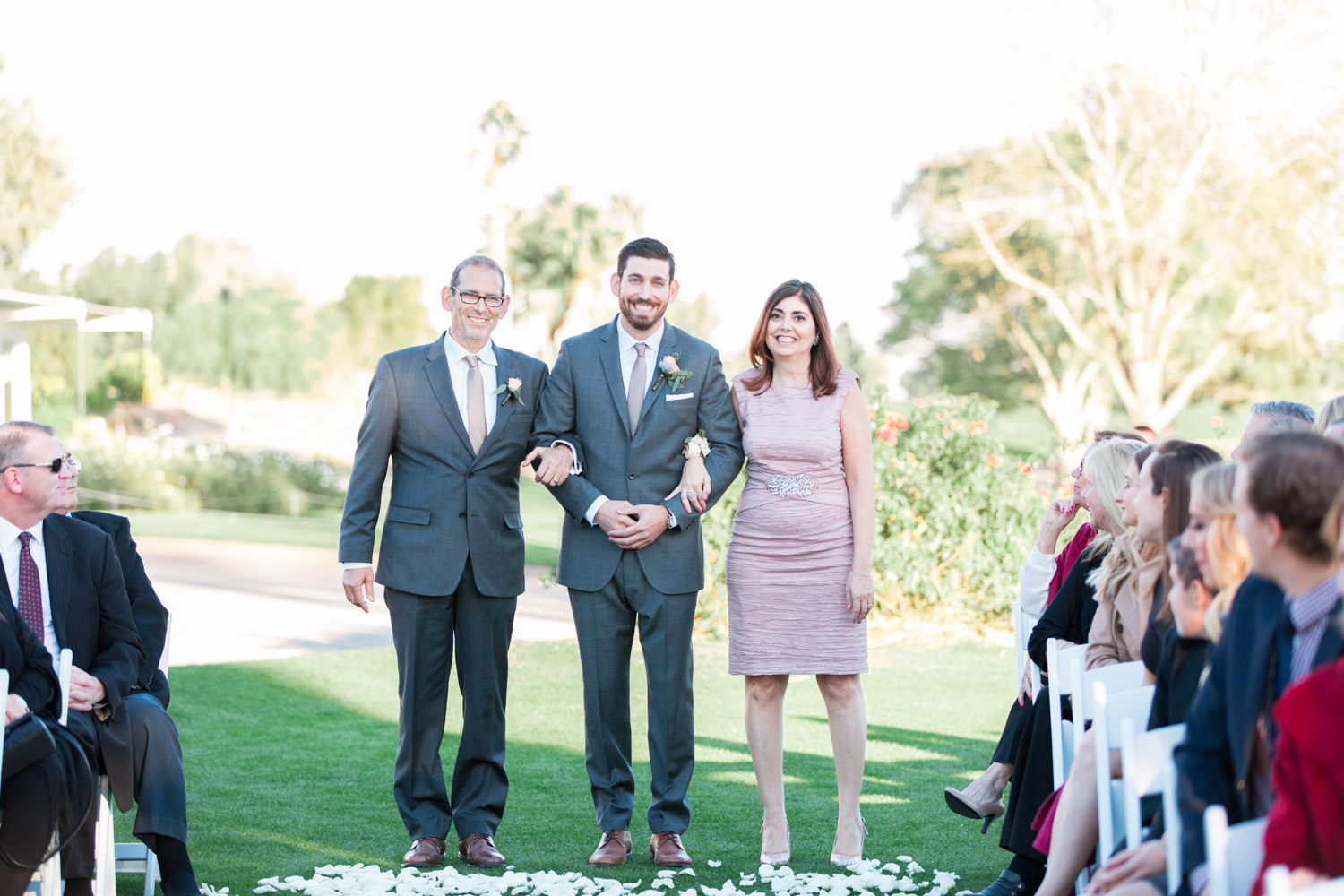 Indian Wells Golf Resort wedding ceremony groom walking parents down the aisle, Cavin Elizabeth Photography