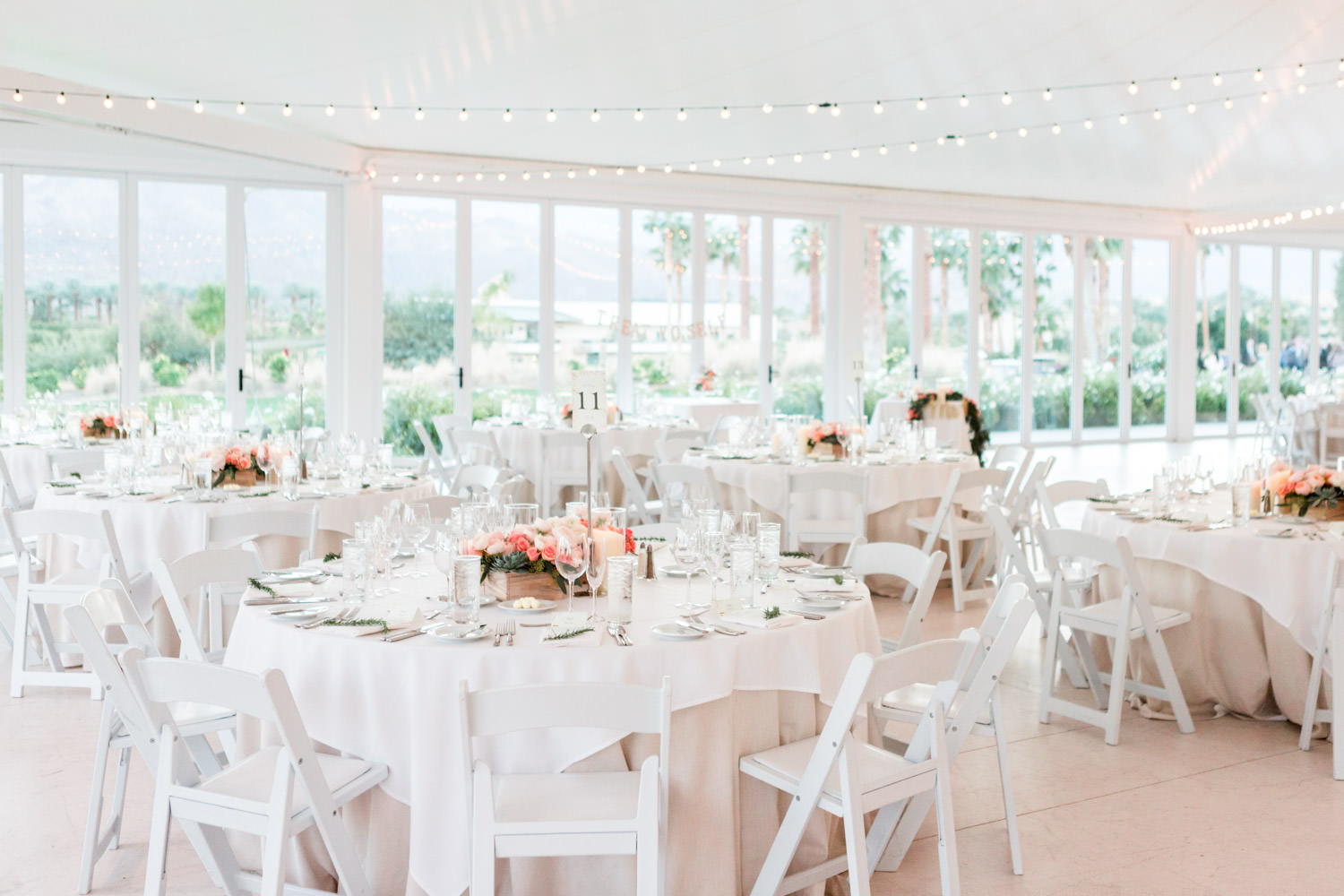 Indian Wells Golf Resort reception pavilion, white tables and chairs with pink and green arrangements, Cavin Elizabeth Photography