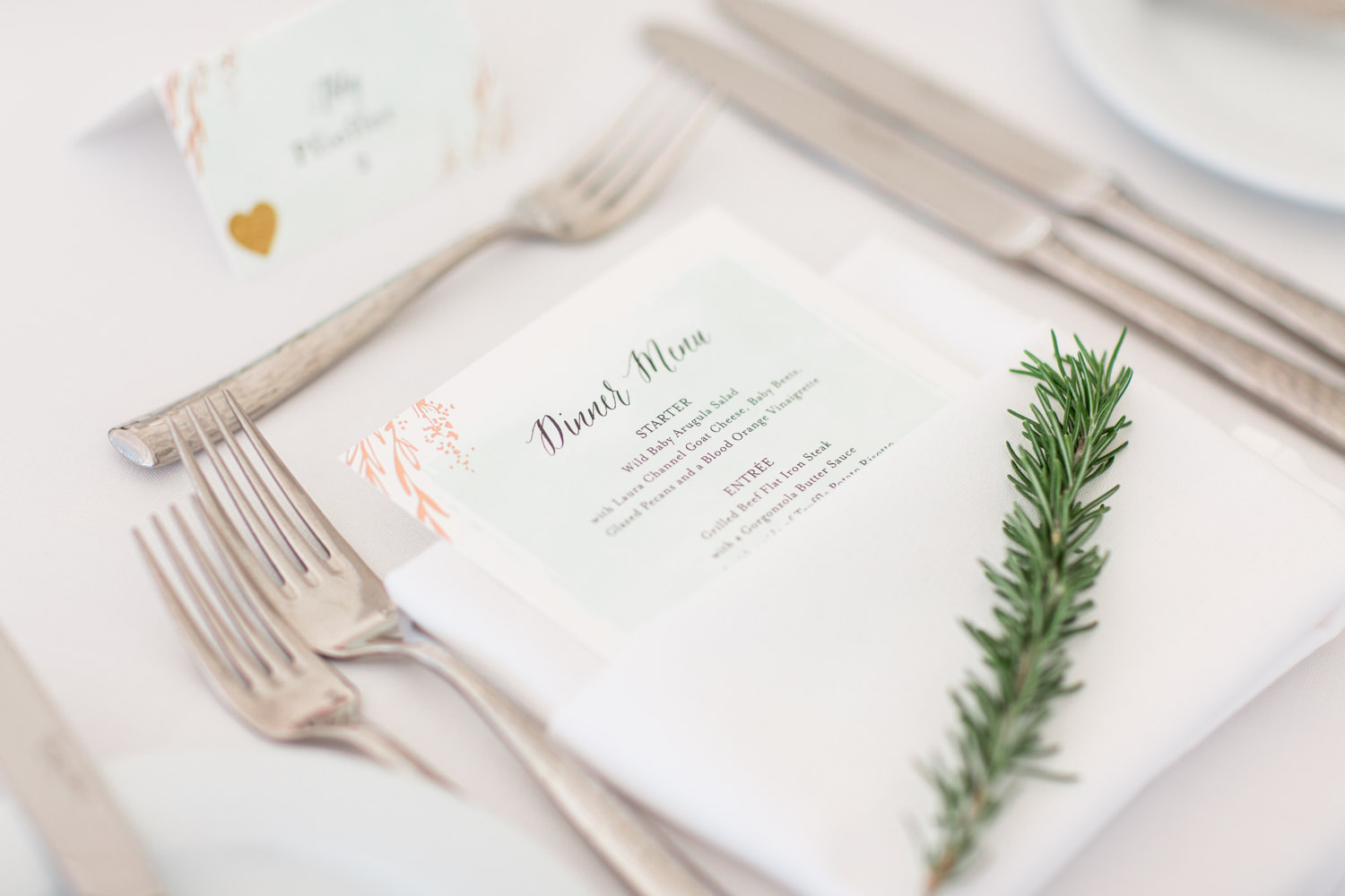 Dinner menu at Indian Wells Golf Resort reception pavilion, white tables and chairs with pink and green arrangements, Cavin Elizabeth Photography