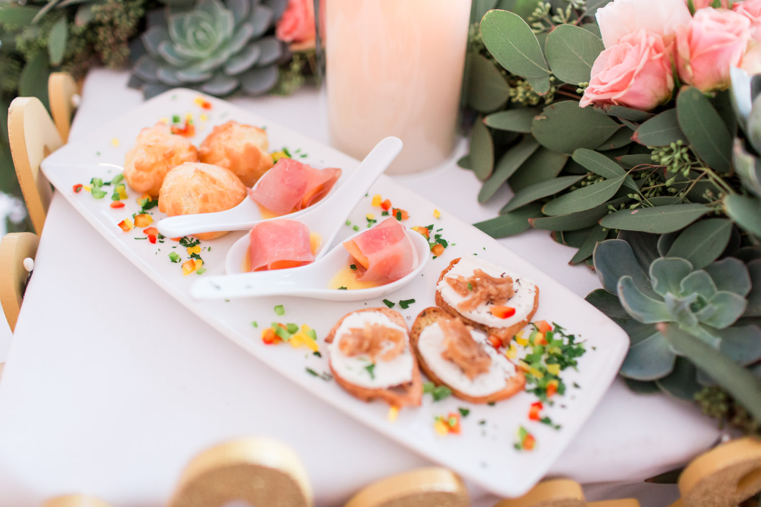 Appetizers and h'ordeuvres table at Indian Wells Golf Resort reception pavilion, white tables and chairs with pink and green arrangements, Cavin Elizabeth Photography