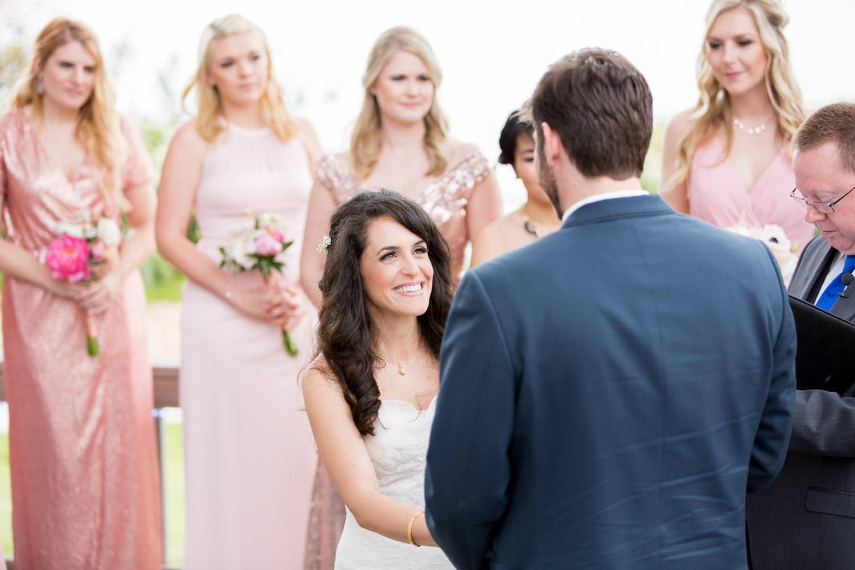 Martin Johnson House Wedding, bride smiling during wedding ceremony in la jolla