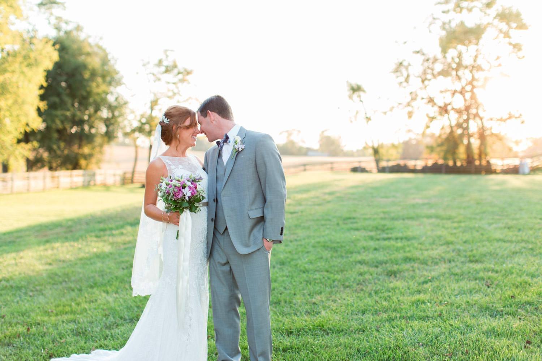 Bride and groom walking around their Maryland wedding venue in Walkersville, Cavin Elizabeth Photography