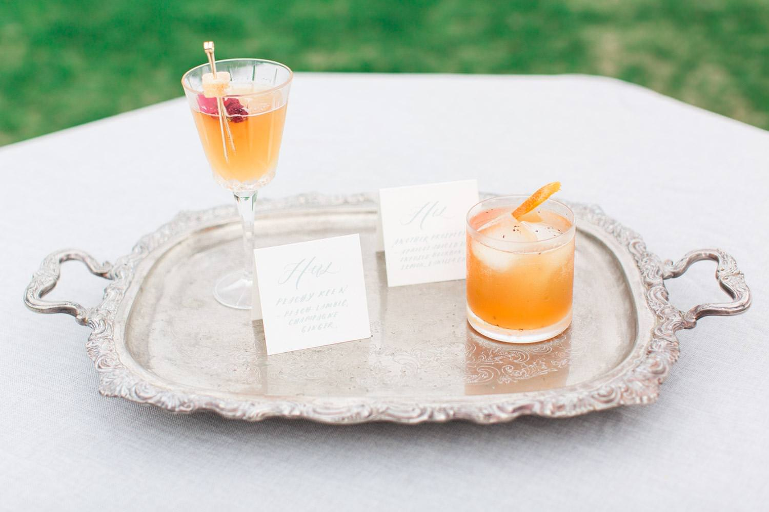 signature wedding cocktails on a silver platter at Rancho Valencia, Cavin Elizabeth Photography