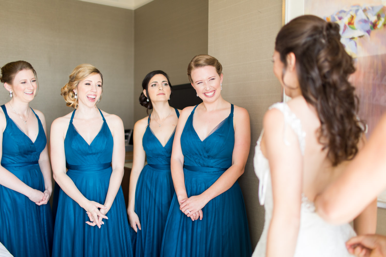 Bridesmaids reacting to Bride getting into gown at Hotel del Coronado suite, Cavin Elizabeth Photography