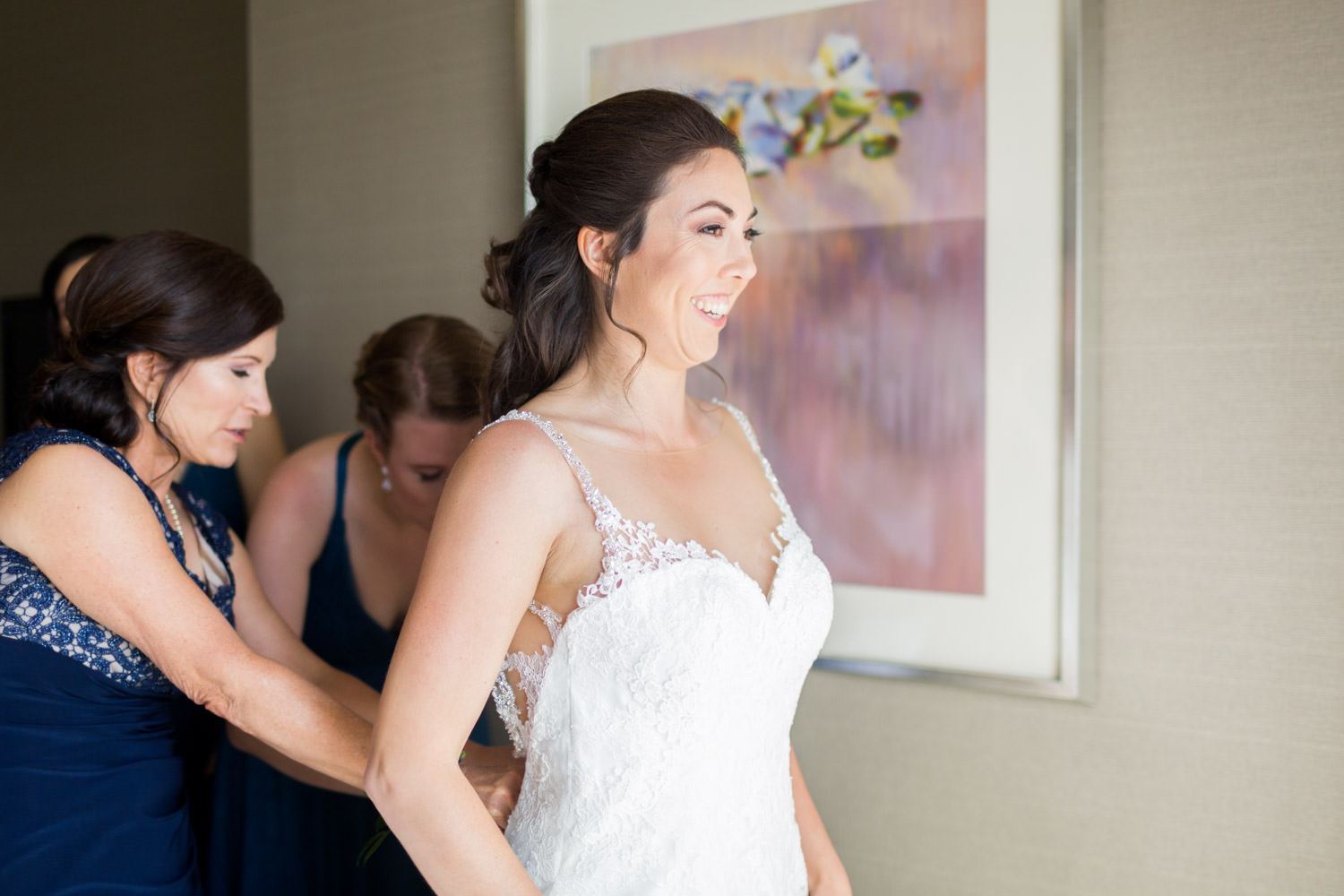 Bride getting into gown at Hotel del Coronado suite, Cavin Elizabeth Photography