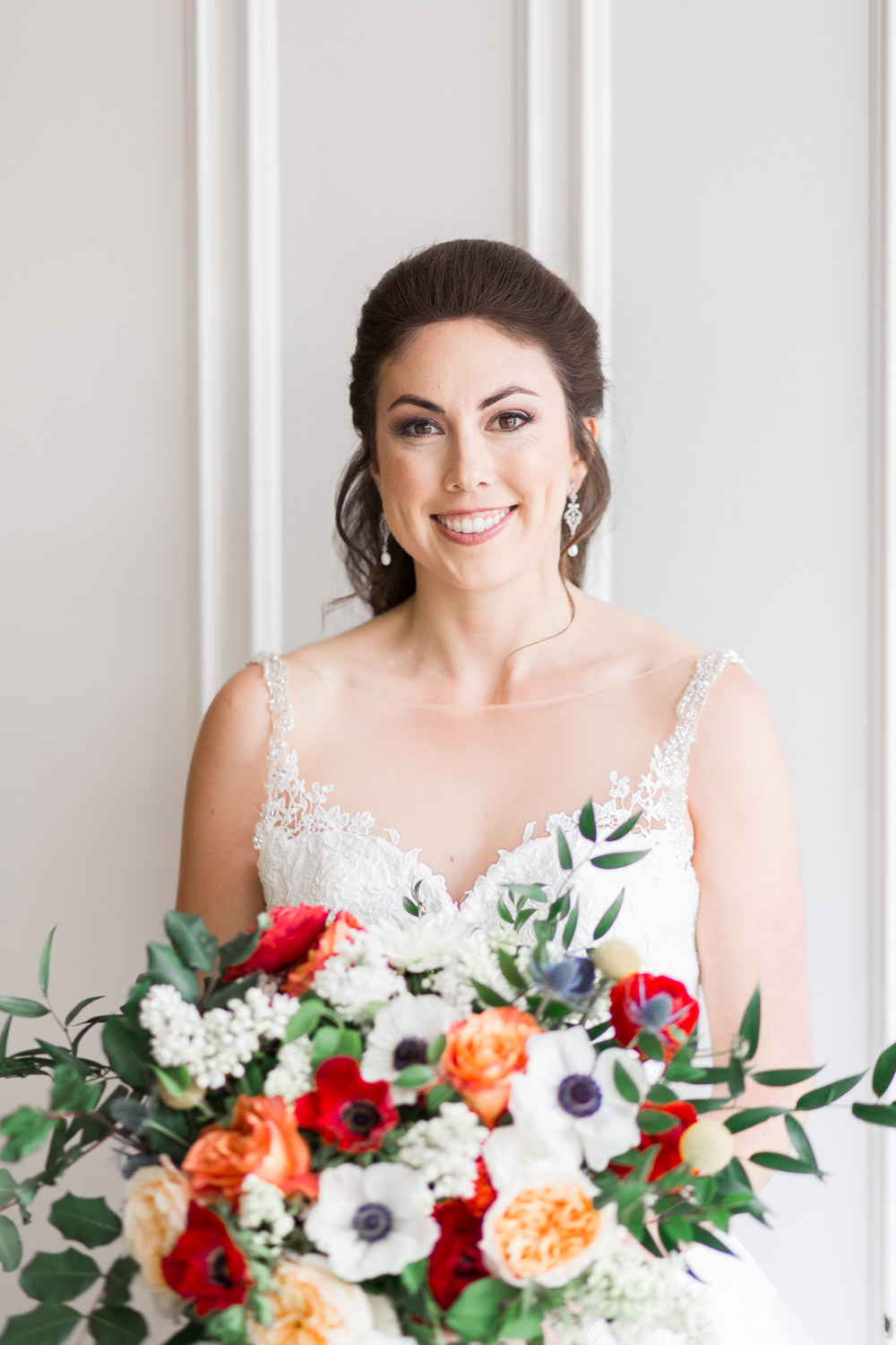 Timeless bridal portrait of bride smiling at the camera in front of a white backdrop, Cavin Elizabeth Photography