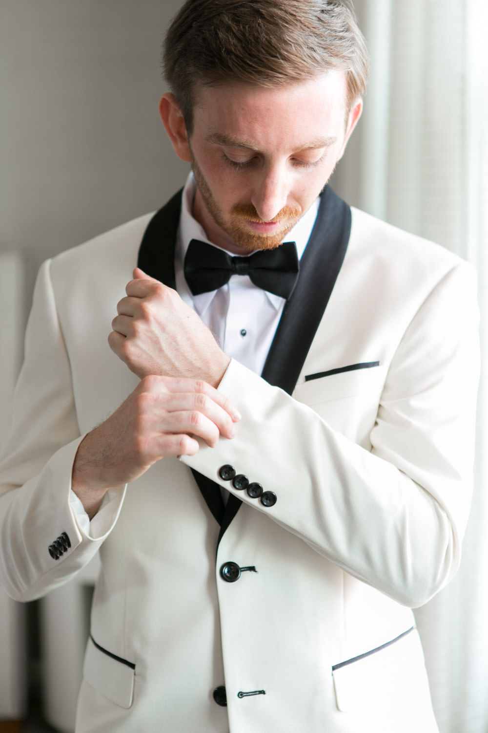 Candid wedding photo of the groom getting his cufflinks on, Hotel del Coronado wedding, Cavin Elizabeth Photography