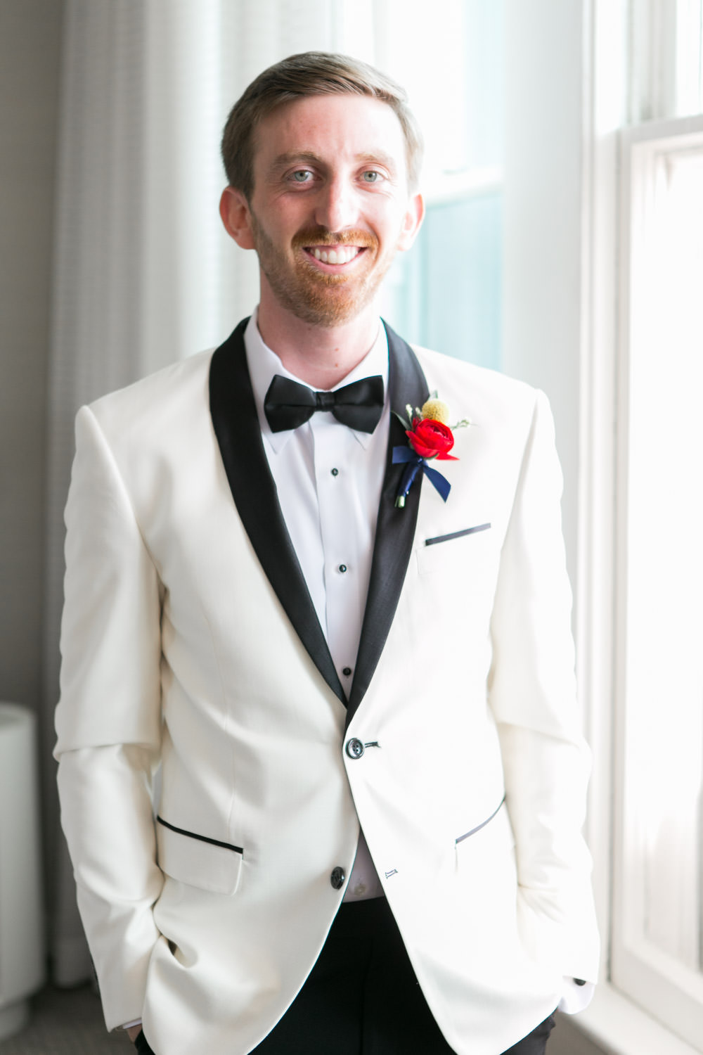 Timeless wedding photo of the groom smiling at the camera, Hotel del Coronado wedding, Cavin Elizabeth Photography