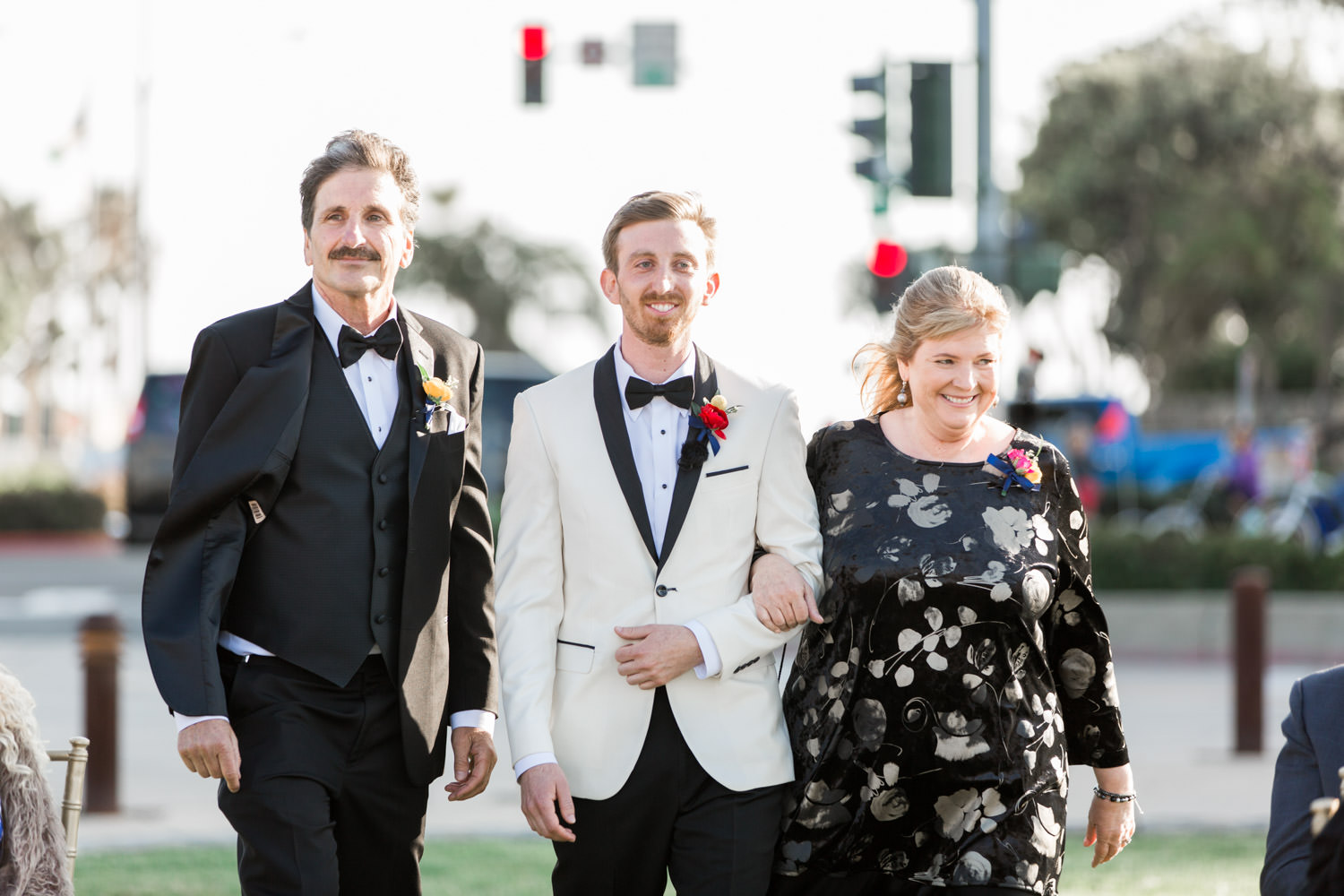 Groom and parents walking down the aisle for a Coronado Community Center Wedding Ceremony, Cavin Elizabeth Photography