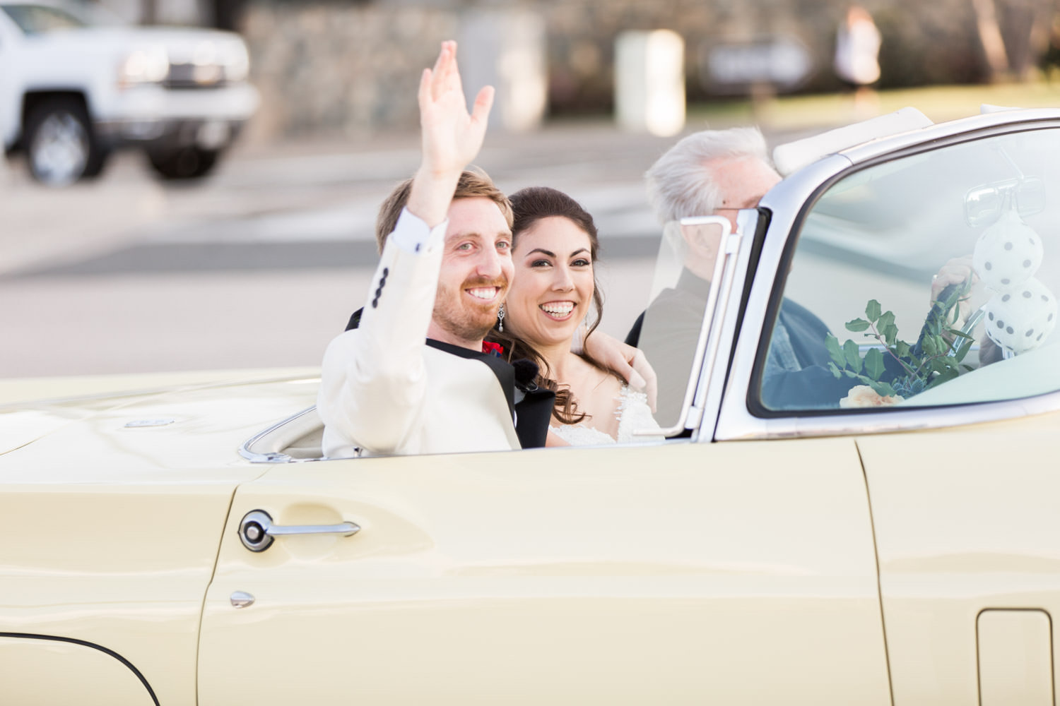 Bride and groom in a Yellow vintage wedding getaway car, Cavin Elizabeth Photography