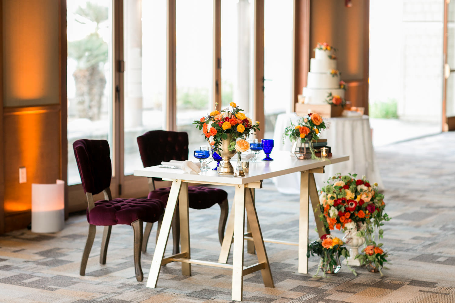 Mid-century modern sweetheart tableCoronado Community Center Wedding reception by Coastyle Events, sophisticated sports vintage themed decor with blue red yellow and peach and green, Cavin Elizabeth Photography