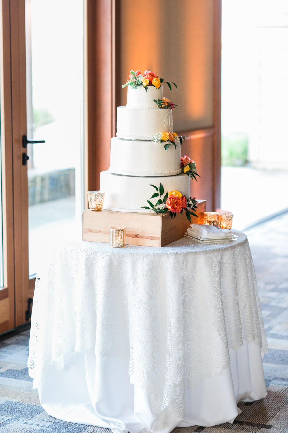Four tier wedding cake with red and yellow flowers, Coronado Community Center Wedding reception by Coastyle Events, sophisticated sports vintage themed decor with blue red yellow and peach and green, Cavin Elizabeth Photography