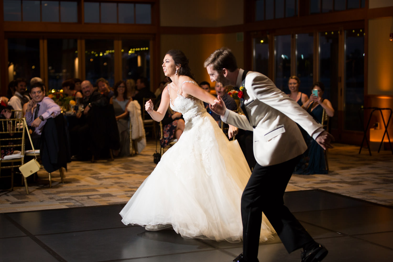 Bride and groom first dance at their wedding reception at the Coronado Community Center, Cavin Elizabeth Photography