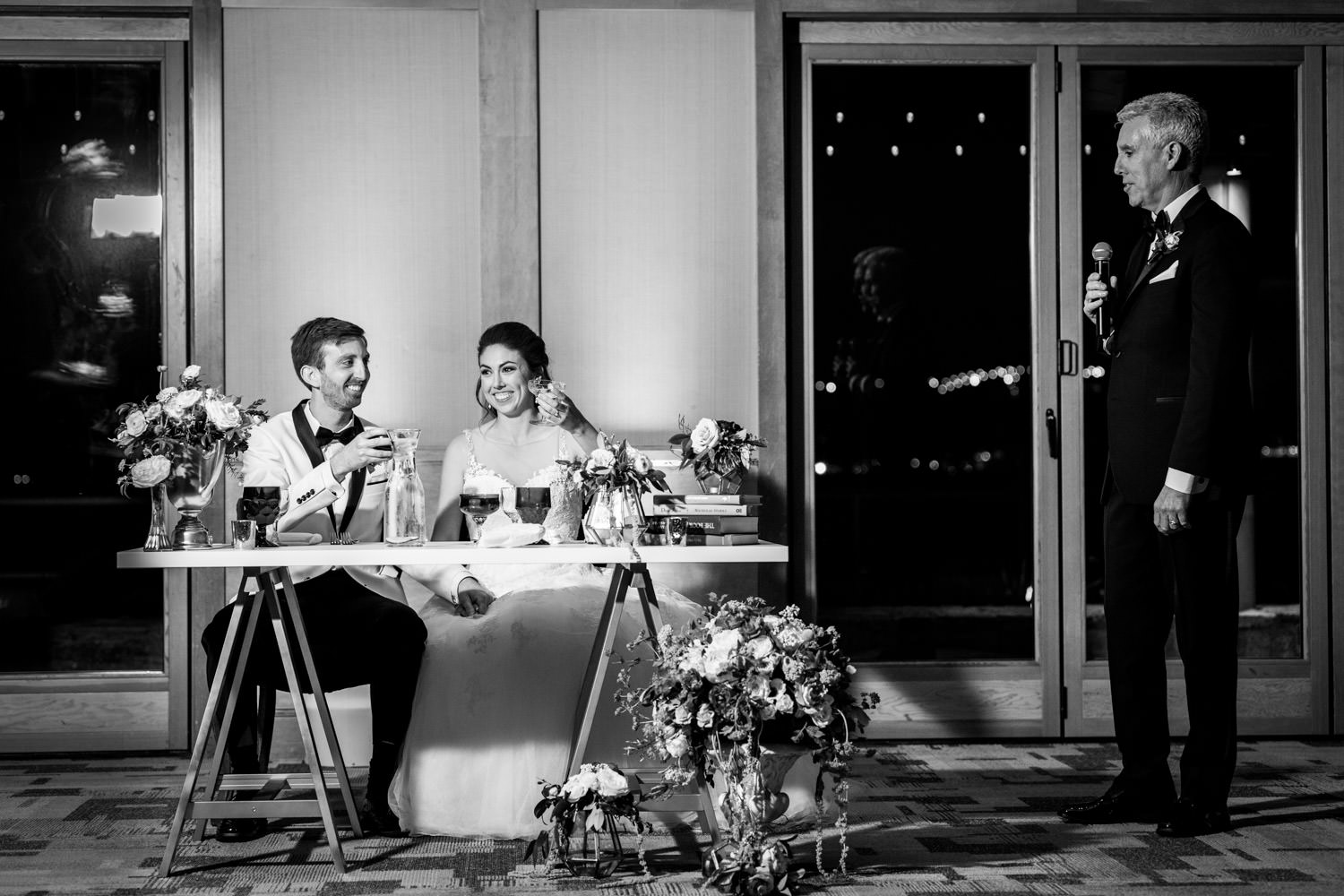 Bride and groom toasts at their wedding reception at the Coronado Community Center, Cavin Elizabeth Photography