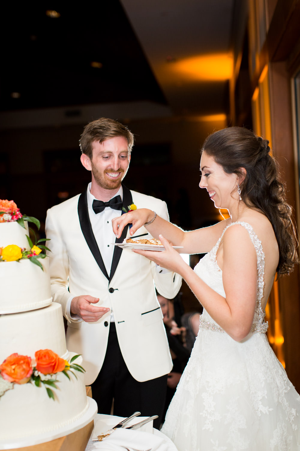 Bride and groom cake cutting at their wedding reception at the Coronado Community Center, Cavin Elizabeth Photography