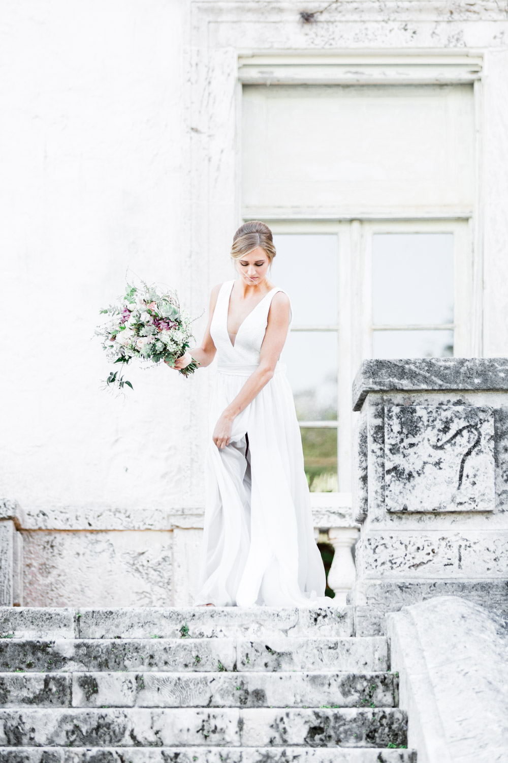 Fine art Miami Vizcaya Wedding Photography, Cavin Elizabeth Photography, bridal portrait with bouquet coming down the stairs