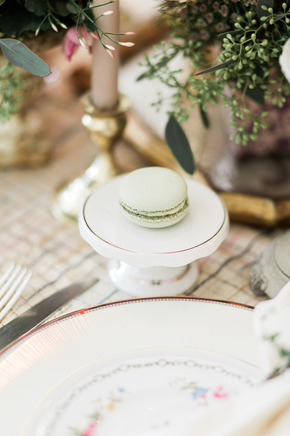 Pistachio macaron light green on a small cake stand, Cavin Elizabeth Photography