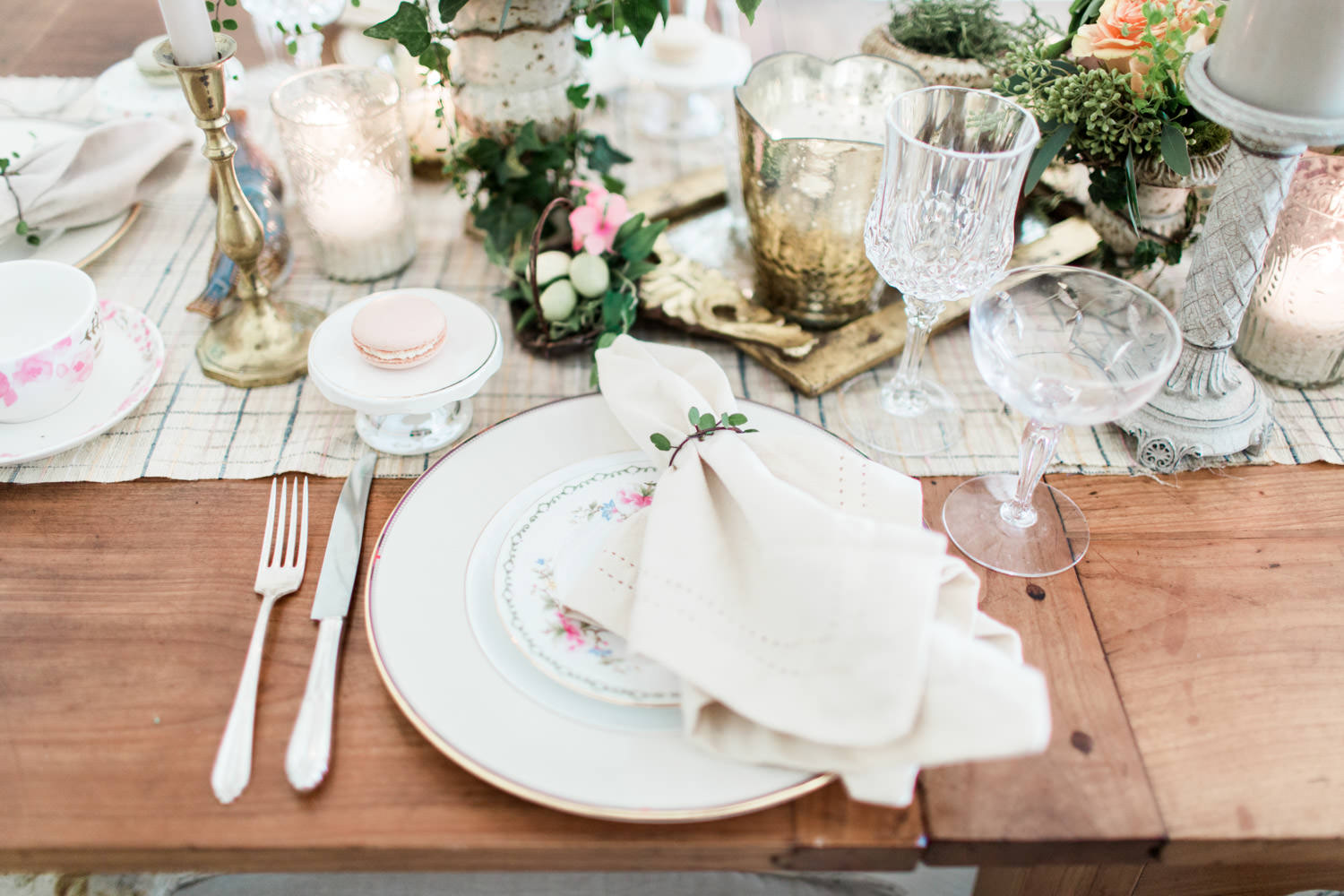 Neutral place setting ideas with napkin tied with greenery and macaron, Cavin Elizabeth Photography