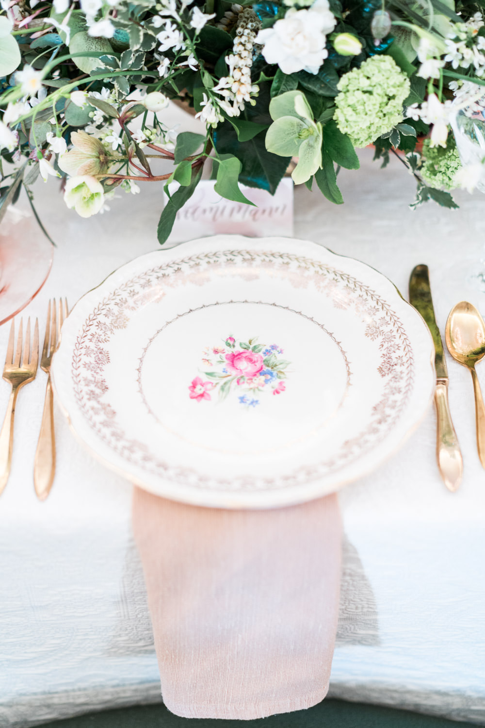 Regal wedding place setting with floral china and blush rose gold napkin and gold flatware, The Crown Inspired Westgate Hotel Wedding in San Diego by Cavin Elizabeth Photography