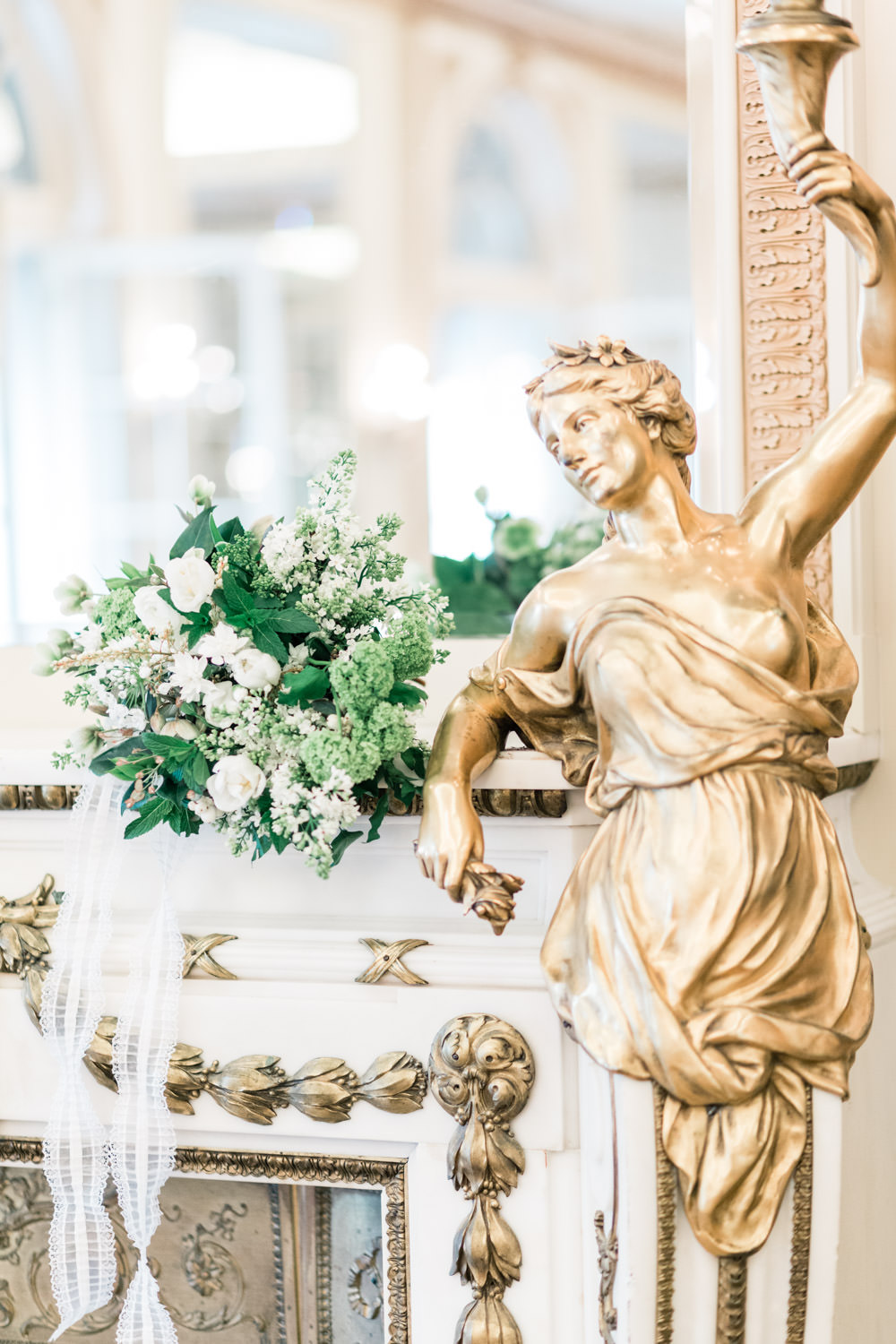 Gold statue fireplace with white and green bouquet, The Crown Inspired Westgate Hotel Wedding in San Diego by Cavin Elizabeth Photography