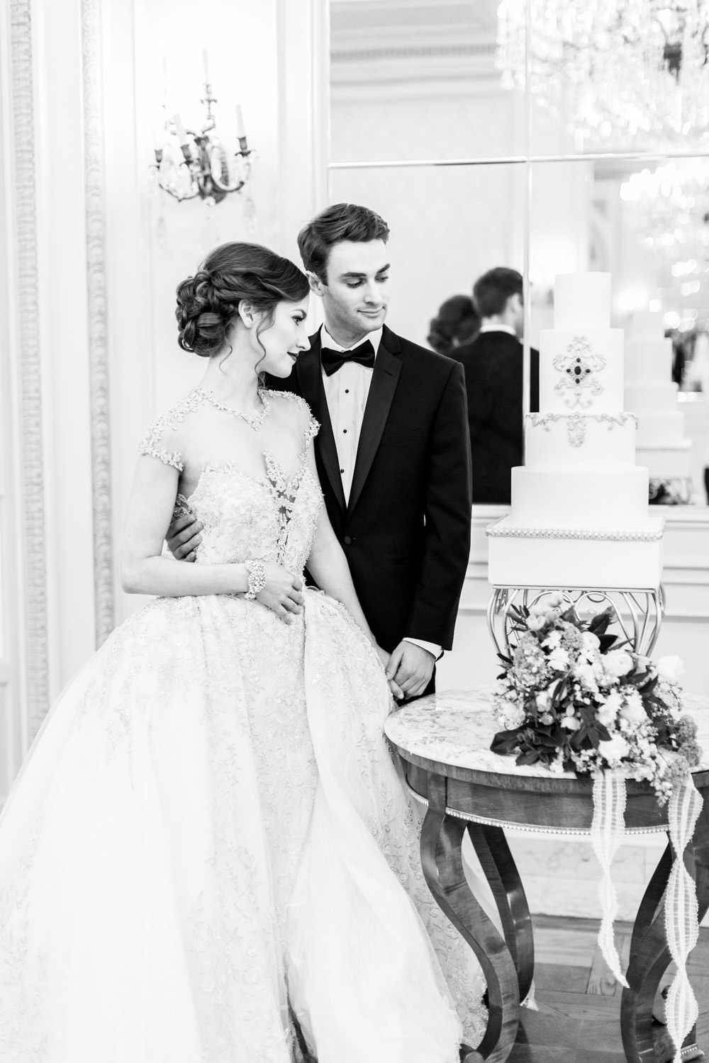 Royal wedding couple with YSA Makino gown cutting wedding cake, The Crown Inspired Westgate Hotel Wedding in San Diego by Cavin Elizabeth Photography