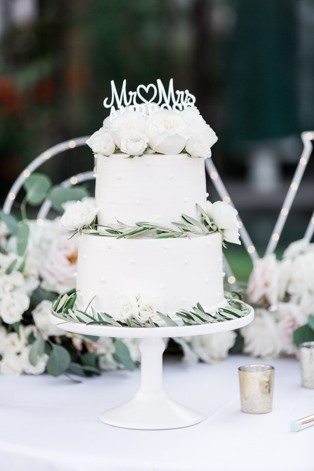 Two tier white wedding cake with roses and greenery, Intimate San Diego Catamaran Resort Wedding on Mission Bay by Cavin Elizabeth