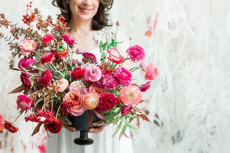 Kiana Underwood with pink large floral arrangement, 1-1 Tulipina Workshop with Cavin Elizabeth Photography San Francisco wedding photographer