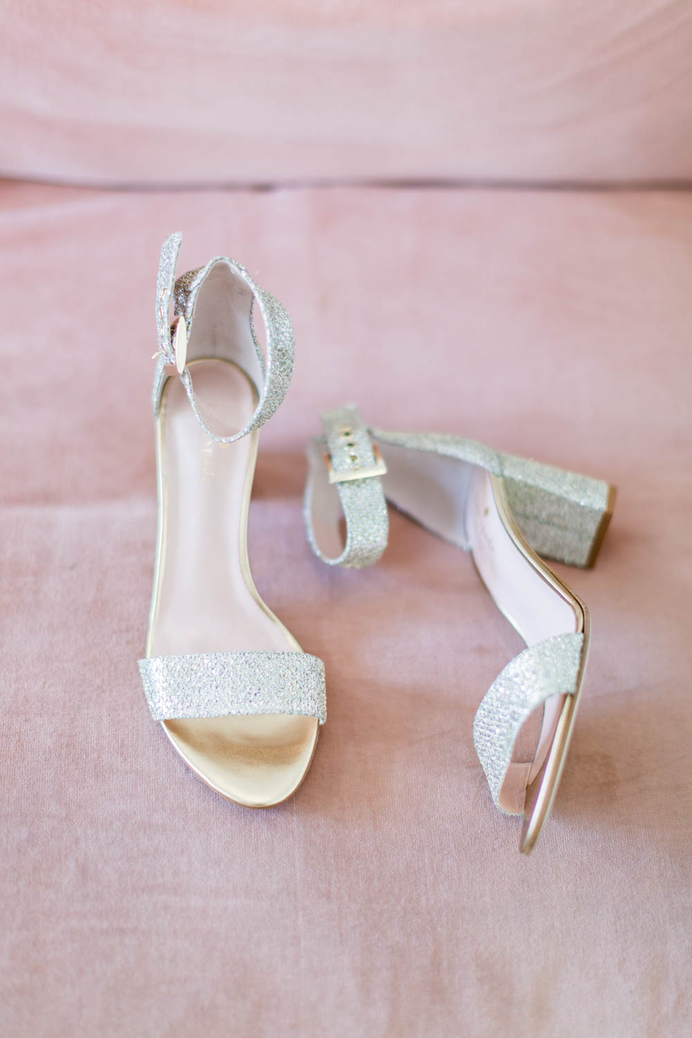 Kate Spade glitter thick wedding heels on a pink sofa, Cavin Elizabeth Photography