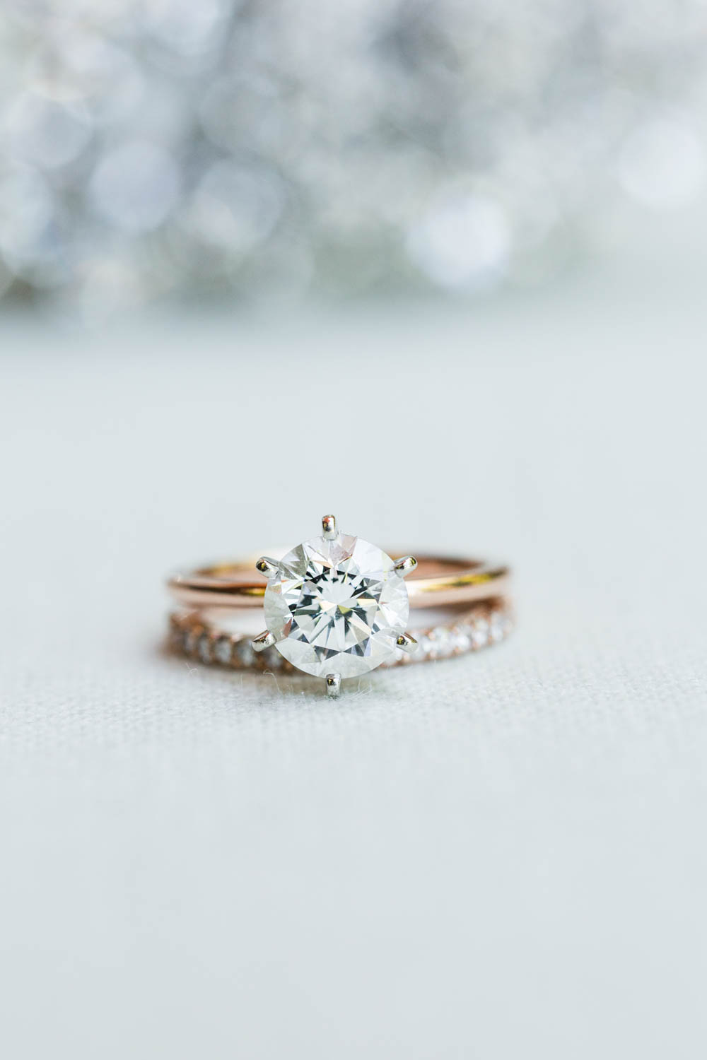 Diamond engagement solitaire ring with rose gold band, Cavin Elizabeth Photography