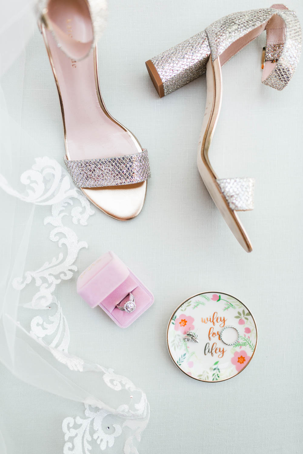 Wedding flatlay of Kate Spade glitter heels ring dish and pink velvet ring box and veil, Cavin Elizabeth Photography